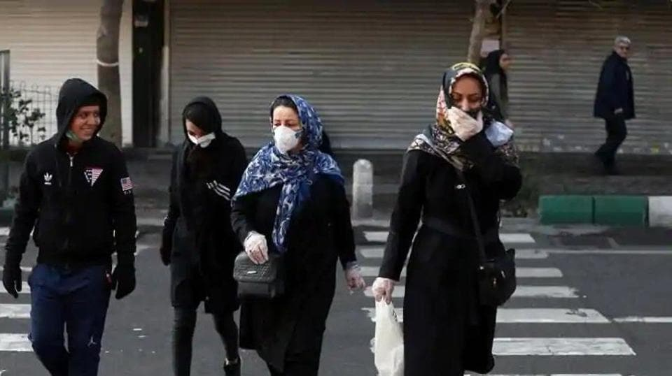 Iranian people wear protective masks to prevent contracting a coronavirus, in Tehran, Iran