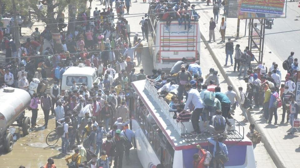 The rush of people wanting to go back home meant that social distancing quickly went out of the window at the bus terminals. (Photo: Sakib Ali/HT photo)