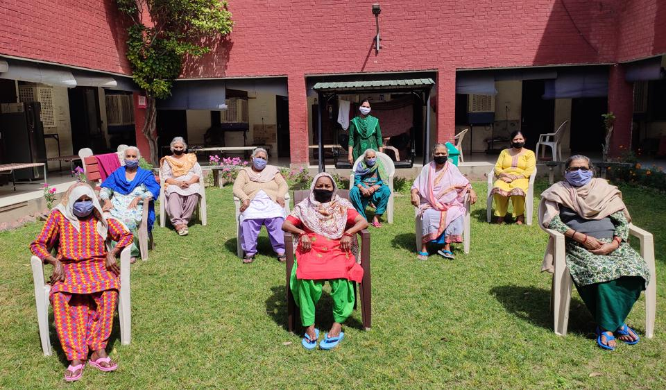 Residents wearing masks and exercising social distancing at the old-age home in Sector 15, Chandigarh.