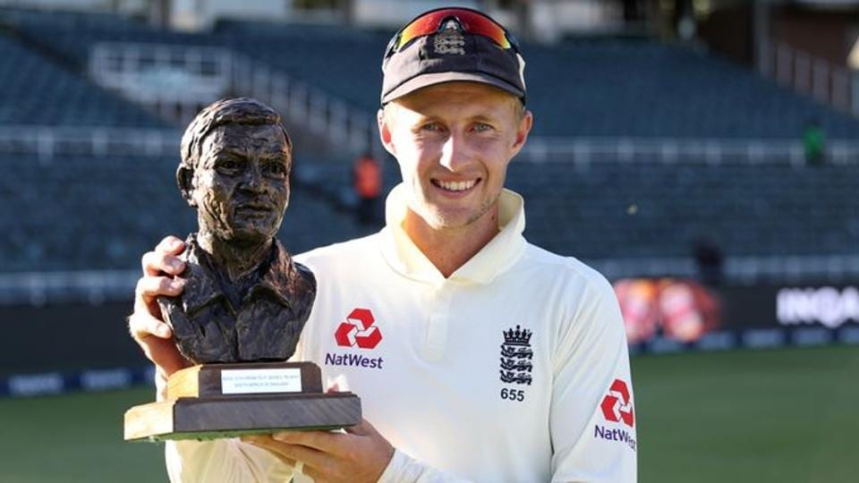 England's Joe Root poses for a photograph as he celebrates with the Basil D'Oliveira trophy.