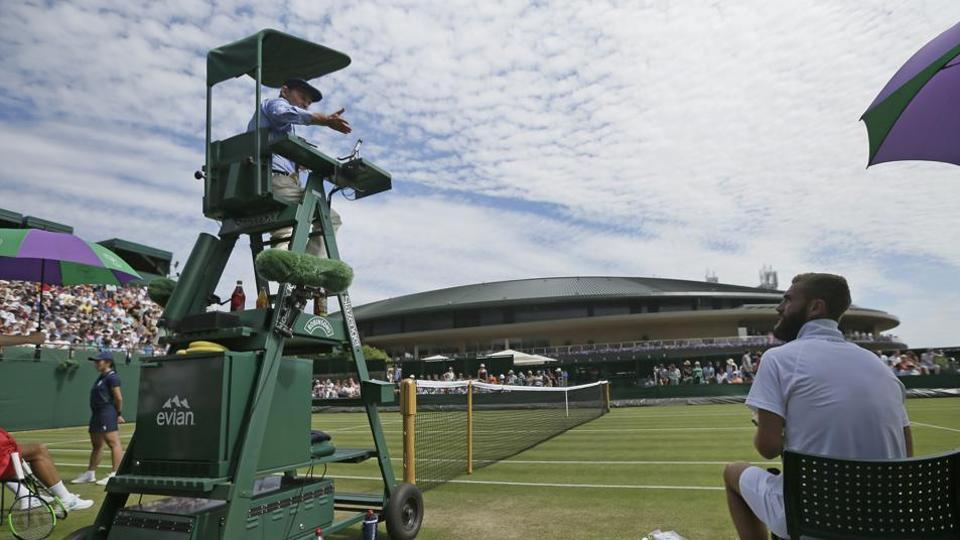 Benoit Paire of France speaks with umpire Gianluca Moscarella at the 2019 Wimbledon Tennis Championships.
