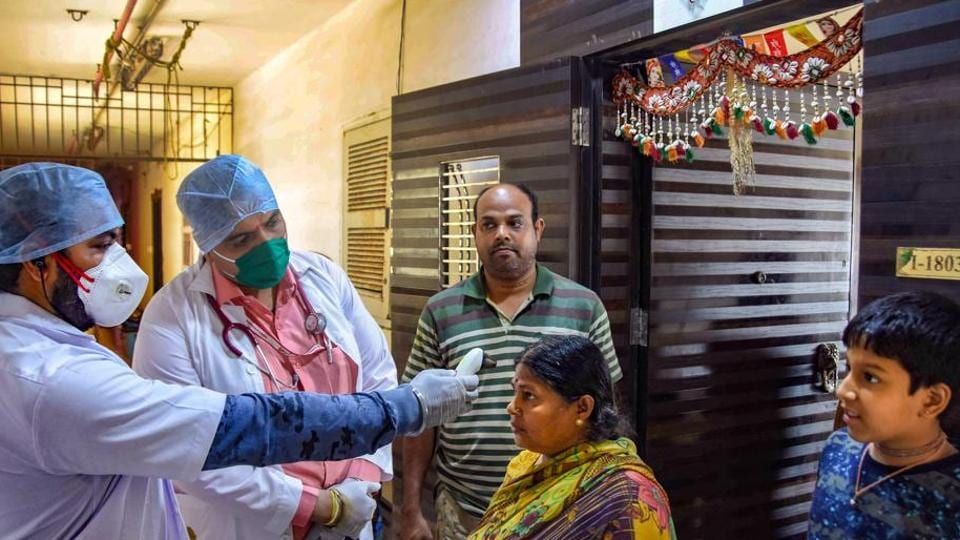 Medics from Rs 1 clinic conduct a door-to-door thermal screening of residents, during a nationwide lockdown, imposed in the wake of coronavirus pandemic, in Mumbai on March 29, 2020.
