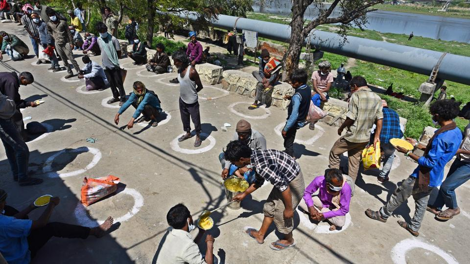 Homeless people are fed at a shelter home while maintaining social distance in demarcated spaces, on day 5 of the 21-day nationwide lockdown imposed by PM Narendra Modi to check the spread of coronavirus
