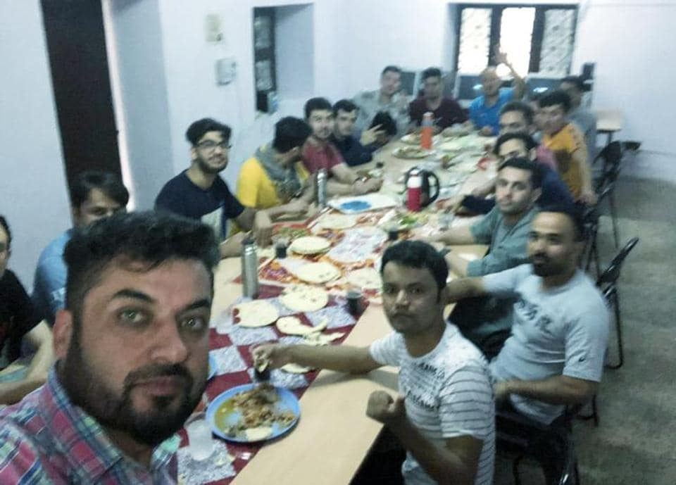 Jawad Majeedy from Afghanistan with other foreign students at hostel.