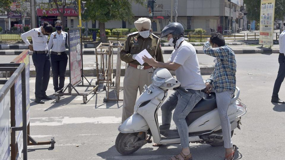 Police personnel check commuters for curfew passes in Punjab's Ludhiana on day 5 of the 21-day nationwide lockdown to check the spread of coronavirus.