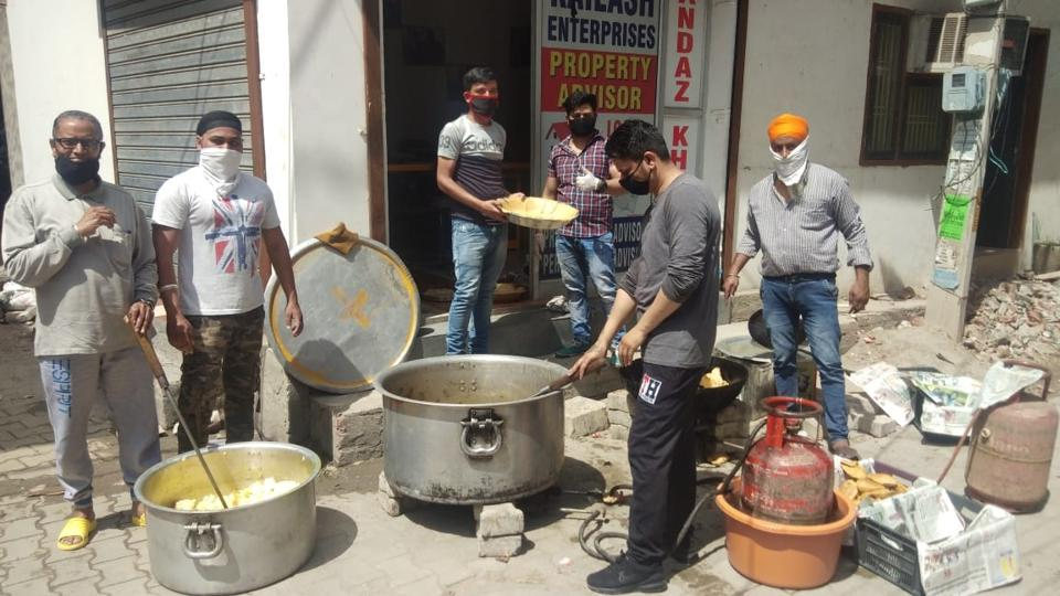 City residents from different locations preparing food for the needy in Ludhiana.