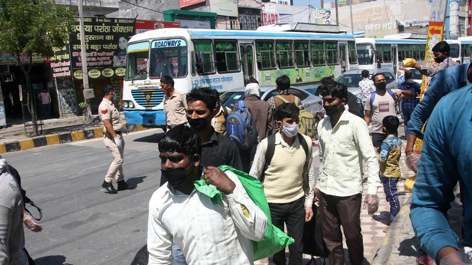 Migrant workers in Haryana's Rohtak headed back home to their towns and villages board on to Roadways buses on day 5 of the 21 day nationwide lockdown to check the spread of coronavirus.