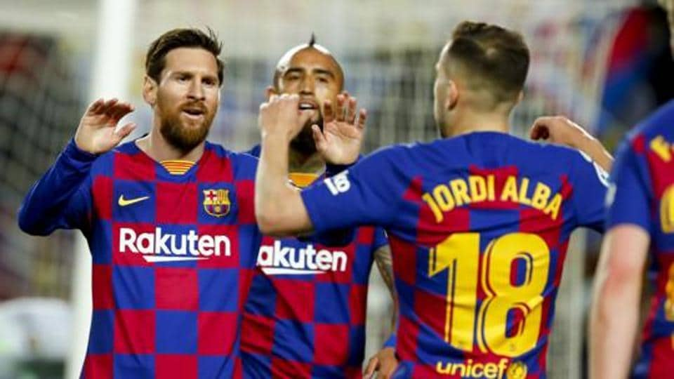 File photo of Lionel Messi with FC Barcelona teammates.