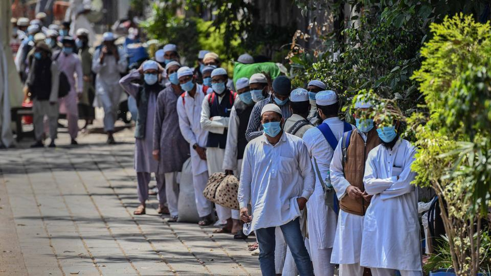 People who took part in a Tablighi Jamaat function earlier this month walk to board buses taking them to a quarantine facility amid concerns of infection at Nizamuddin West in New Delhi on Tuesday, March 31, 2020.