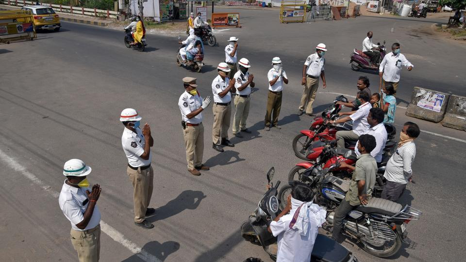 Traffic policemen request commuters to wear masks and to stay at home during a 21-day nationwide lockdown to limit the spreading of coronavirus disease, in Andhra Pradesh's Vijayawada  on March 27.
