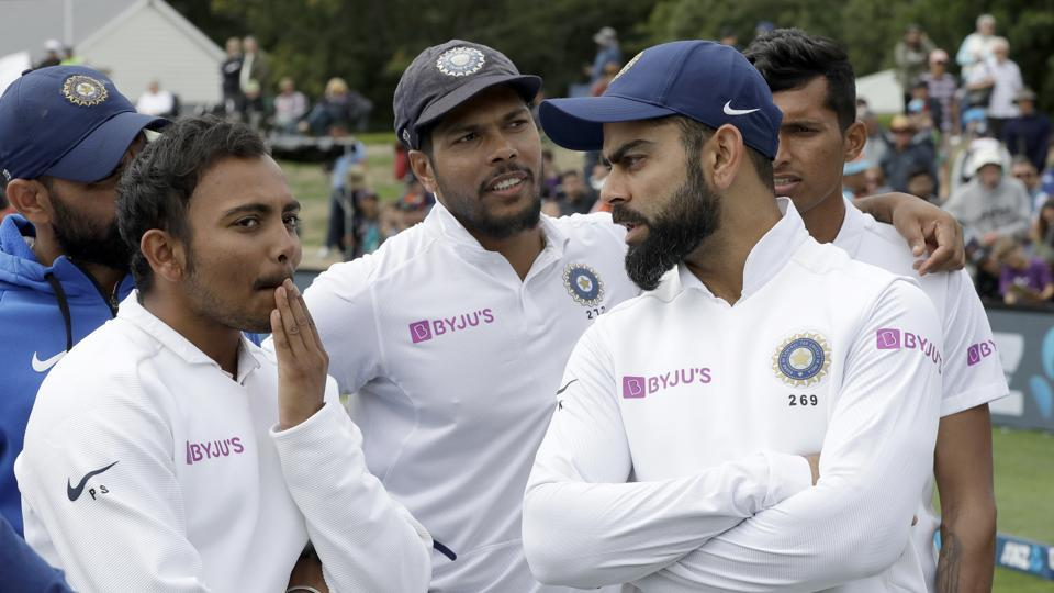 India's Virat Kohli, right, talks with his teammates