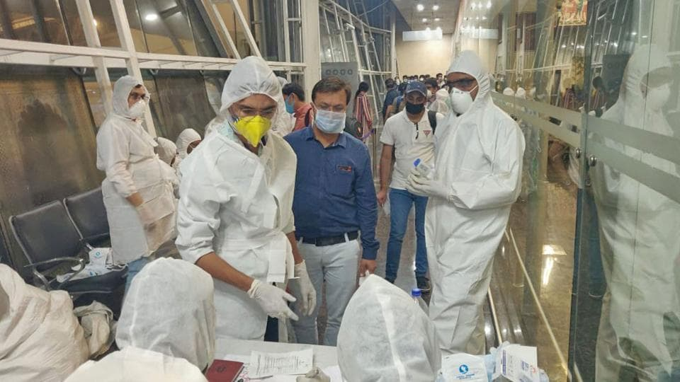 Health officials screen passengers arriving from Dubai before being sent to hospital in the wake of coronavirus pandemic, in Indore, on March 20.