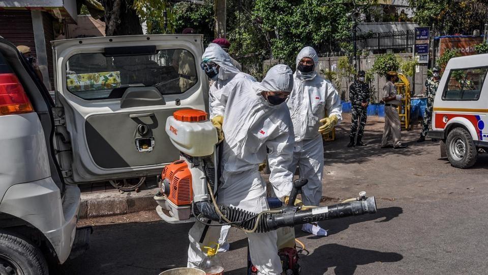Delhi Government public health employees prepare gear to sanitize the Alami Markaz Banglewali Masjid area at Nizamuddin.