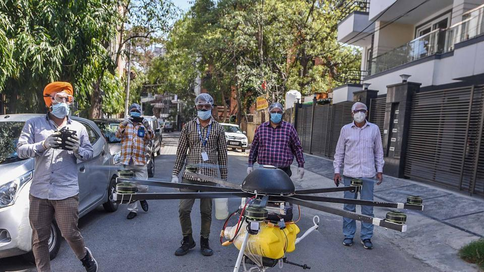 Drones being used by municipal employees to spray disinfectant during a sanitisation drive on day nine of the 21-day nationwide lockdown at Nizamuddin West, New Delhi, April 2, 2020