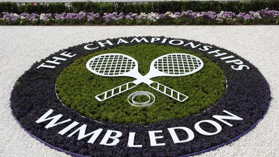 A Wimbledon logo is seen inside the grounds at the Wimbledon tennis championships in London.