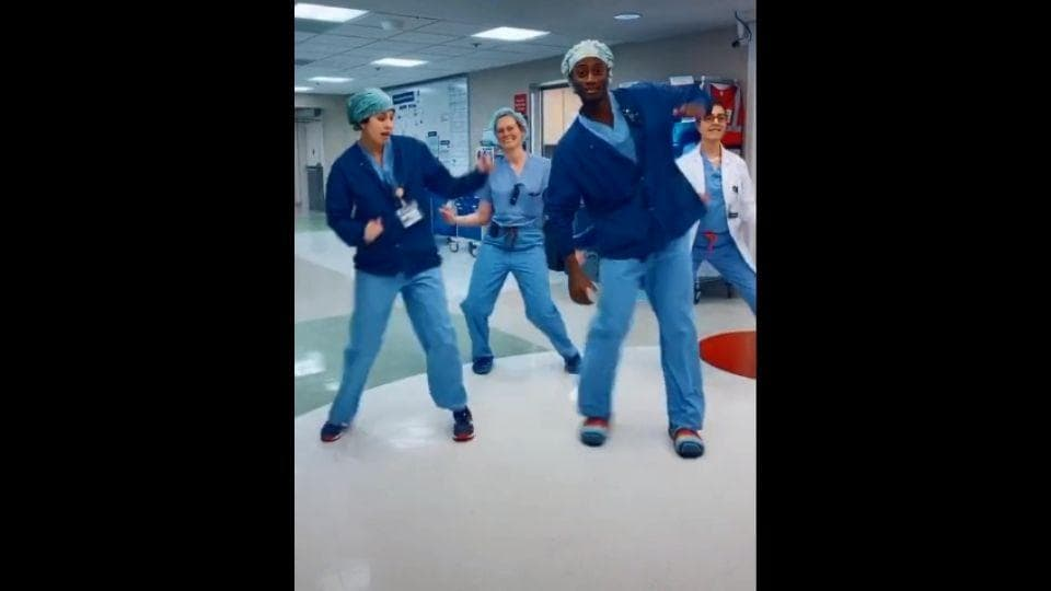 The image shows the doctors and medical workers dancing.