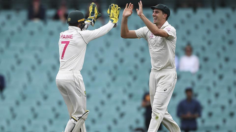 Australia's Tim Paine, left, celebrates with Pat Cummins