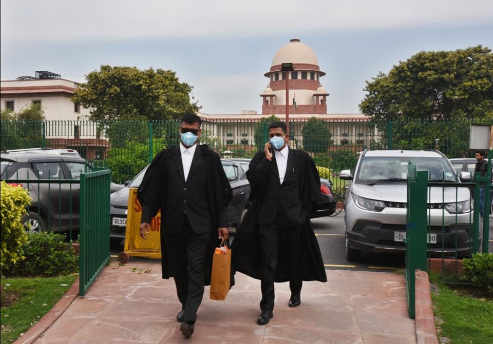Advocates wearing protective masks as a precautionary measure amid rising coronavirus scare, at Supreme Court area, Bhagwan Dass road, in New Delhi.