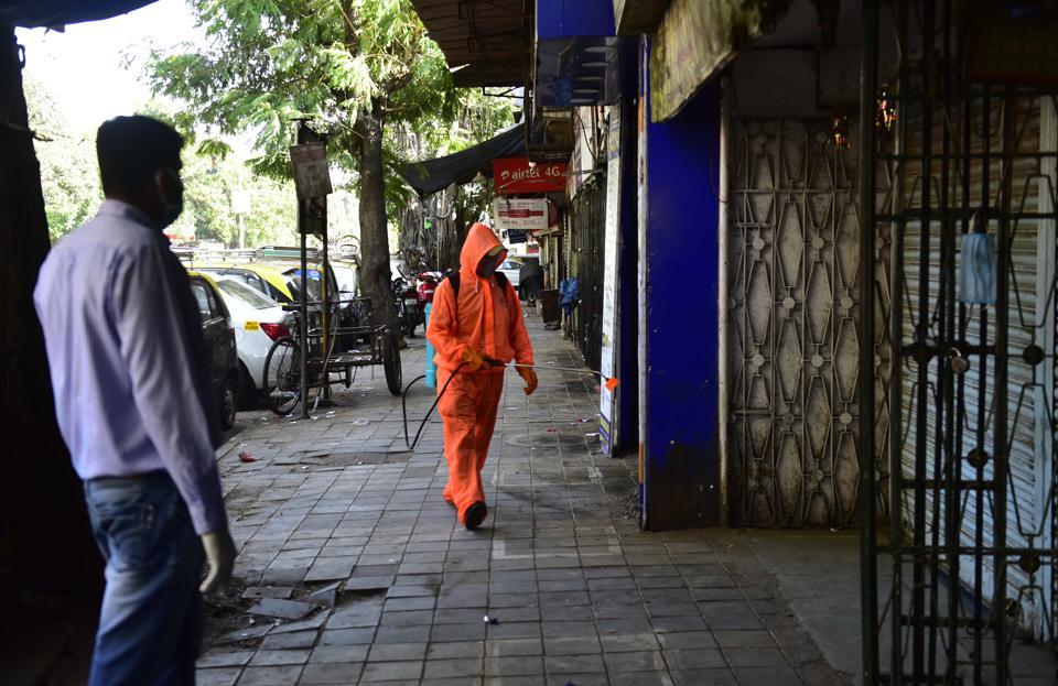 Civic workers sanitizing a quarantine facility in Mumbai.