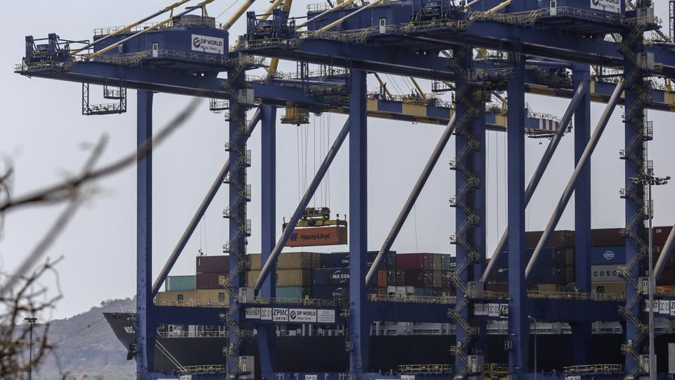 A gantry crane transports a shipping container at the Jawaharlal Nehru Port, operated by Jawaharlal Nehru Port Trust (JNPT), in Navi Mumbai.