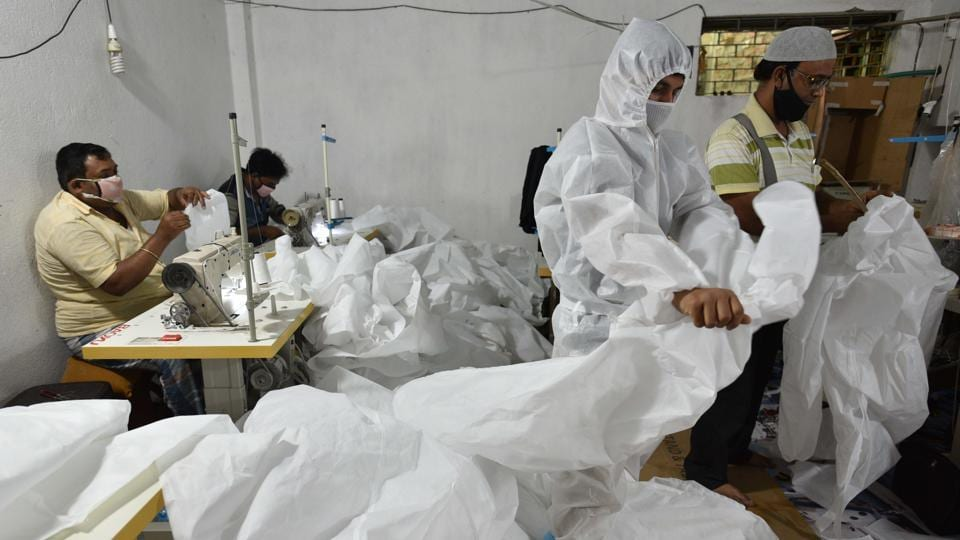 Workers of Maheshtala Bright Tailoring prepare Personal Protective Equipment (PPE) for medical staff at Maheshtala, South 24 Pargana district.