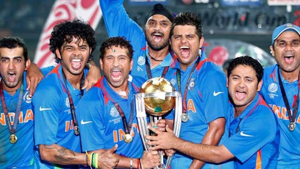 Indian team with the world cup trophy