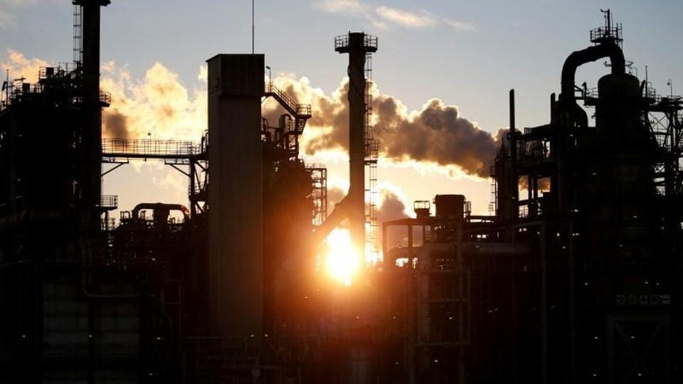 Smoke rises from a factory during sunset at Keihin industrial zone in Kawasaki, Japan.