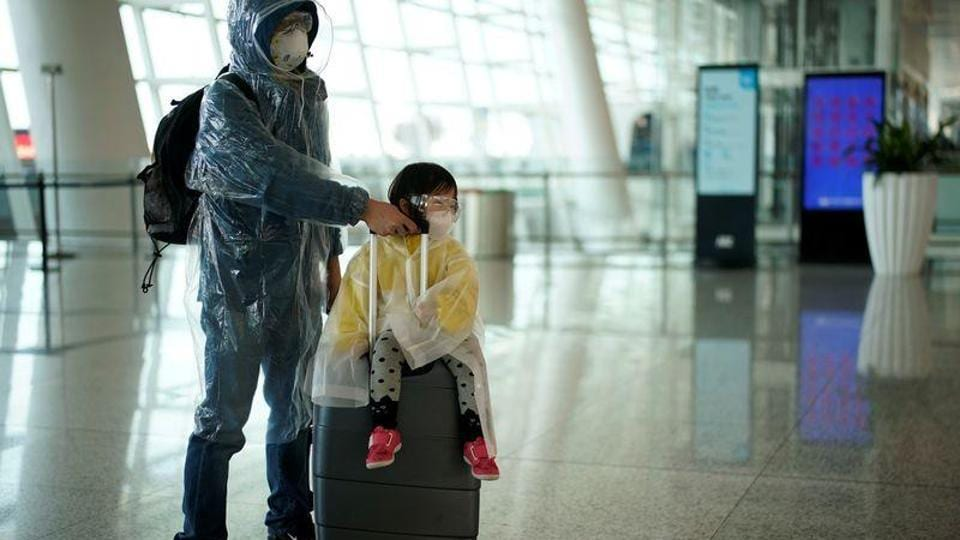 People wearing protective gear are seen at the Wuhan Tianhe International Airport after travel restrictions to leave Wuhan, the capital of Hubei province and China's epicentre of the novel coronavirus disease (COVID-19) outbreak, were lifted.