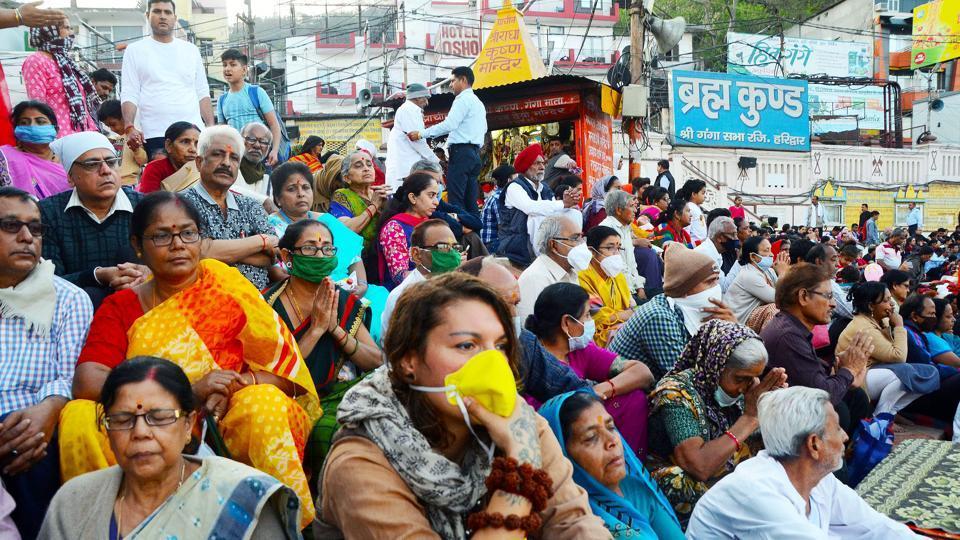 Devotees wearing masks take part in Ganga Aarti at Har Ki Pauri, in Haridwar in this file photo.