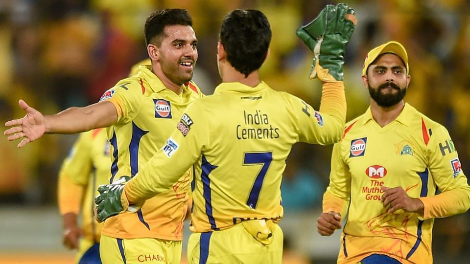 Chennai Super Kings (CSK) bowler Deepak Chahar (L) celebrates with teammates