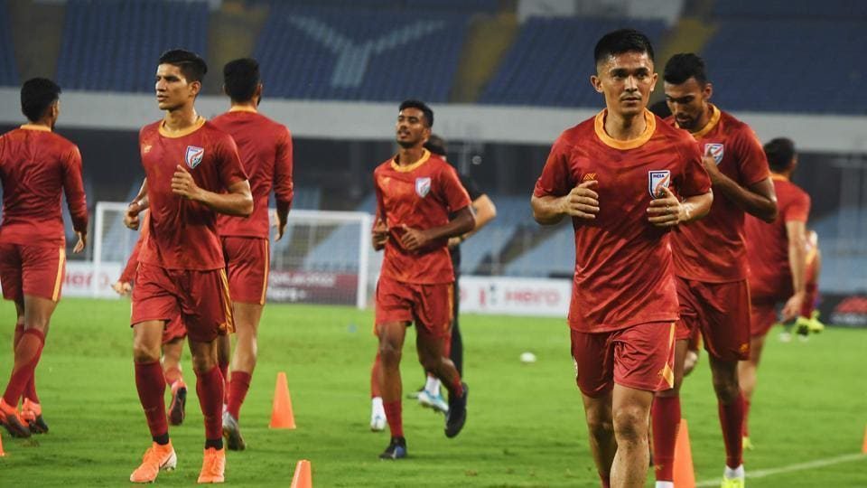 India's national football team captain Sunil Chhetri (2R) along with teammates takes part in a training session .