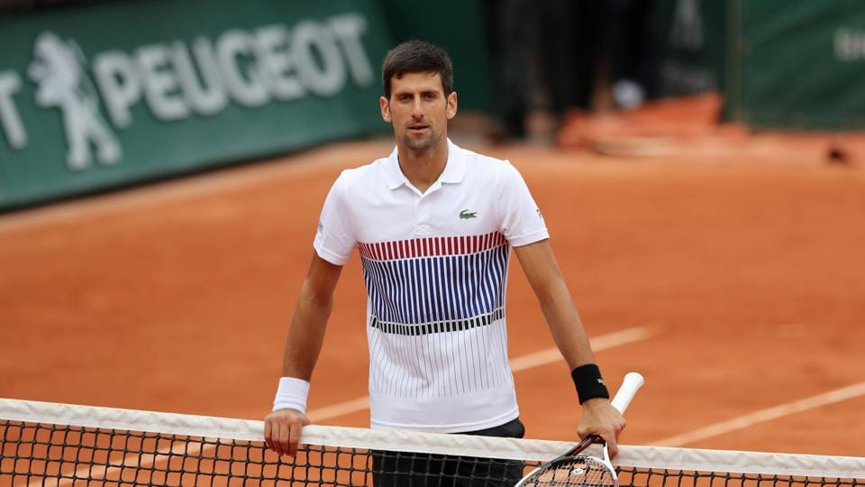 Serbia's Novak Djokovic looks dejected after losing his quarter final match against Austria's Dominic Thiem.