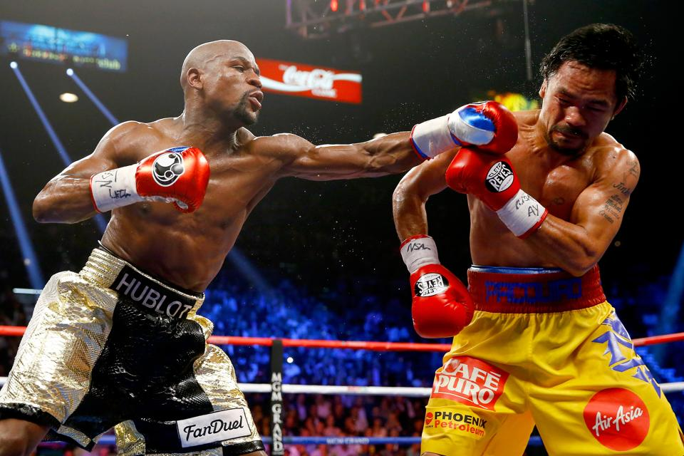 Floyd Mayweather Jr. throws a left at Manny Pacquiao during their welterweight unification championship bout on May 2, 2015 at MGM Grand Garden Arena in Las Vegas, Nevada.