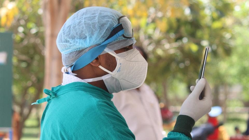 A doctor wearing protective face mask and hairnet at a Covid-19 help desk at Civil Hospital in Gurugram, India, on Thursday.