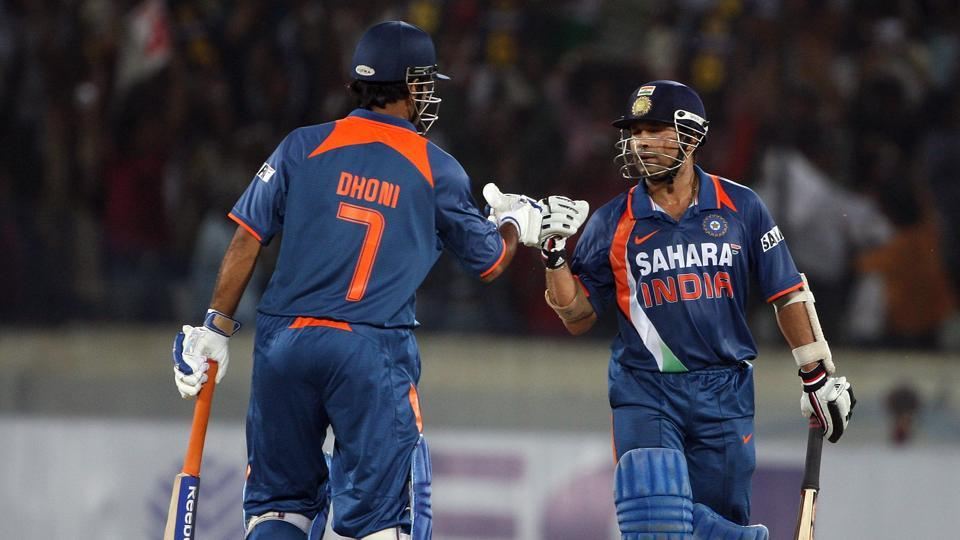 MS Dhoni and Sachin Tendulkar of India punch gloves during the fifth One Day International match between India and Australia at Rajiv Gandhi International Cricket Stadium on November 5, 2009 in Hyderabad, India.