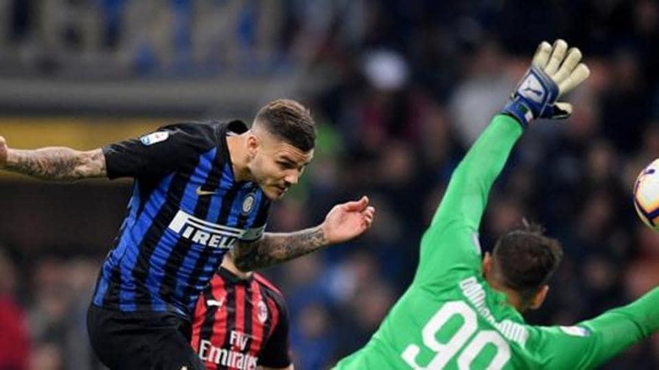 Soccer Football - Serie A - Inter Milan v AC Milan - San Siro, Milan, Italy - October 21, 2018 Inter Milan's Mauro Icardi scores their first goal REUTERS/Alberto Lingria
