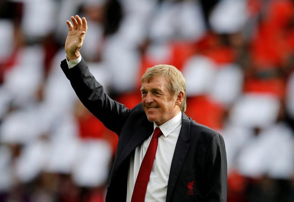 Kenny Dalglish waves to the fans before the match.