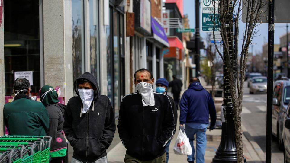 Pedestrians walk along Devon Avenue during the global outbreak of coronavirus disease (COVID-19) in Chicago, Illinois, U.S. April 11, 2020.