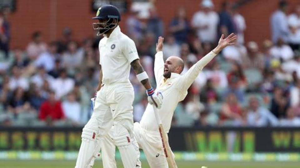 Australia's Nathan Lyon appeals for the wicket of India's Cheteshwar Pujara as India's Virat Kohli, left.
