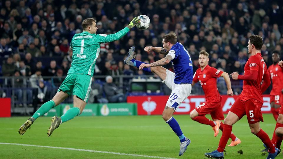 Soccer Football - DFB Cup - Schalke 04 v Bayern Munich - Veltins-Arena, Gelsenkirchen, Germany - March 3, 2020 Schalke 04's Guido Burgstaller in action with Bayern Munich's Manuel Neuer REUTERS/Wolfgang Rattay DFL regulations prohibit any use of photographs as image sequences and/or quasi-video