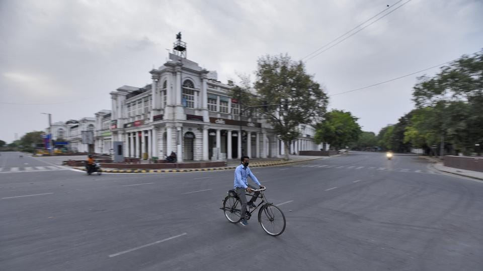 A cyclist seen on a deserted Connaught Place inner circle during the lockdown in New Delhi.