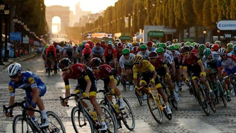 FILE PHOTO: Cycling - Tour de France - The 128-km Stage 21 from Rambouillet to Paris Champs-Elysees - July 28, 2019 - Team INEOS rider Egan Bernal of Colombia, wearing the overall leader's yellow jersey, in action in the peloton. REUTERS/Gonzalo Fuentes/File Photo