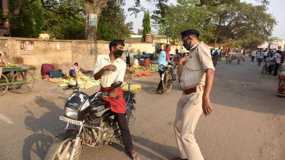 A police personnel hits a person out breaking restrictions at Danapur during lockdown against coronavirus in Patna, Bihar, India on Tuesday April 14, 2020.