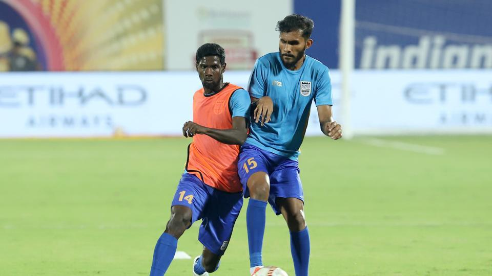 Rowllin Borges of Mumbai City FC and Subhasish Bose of Mumbai City FC warming up.