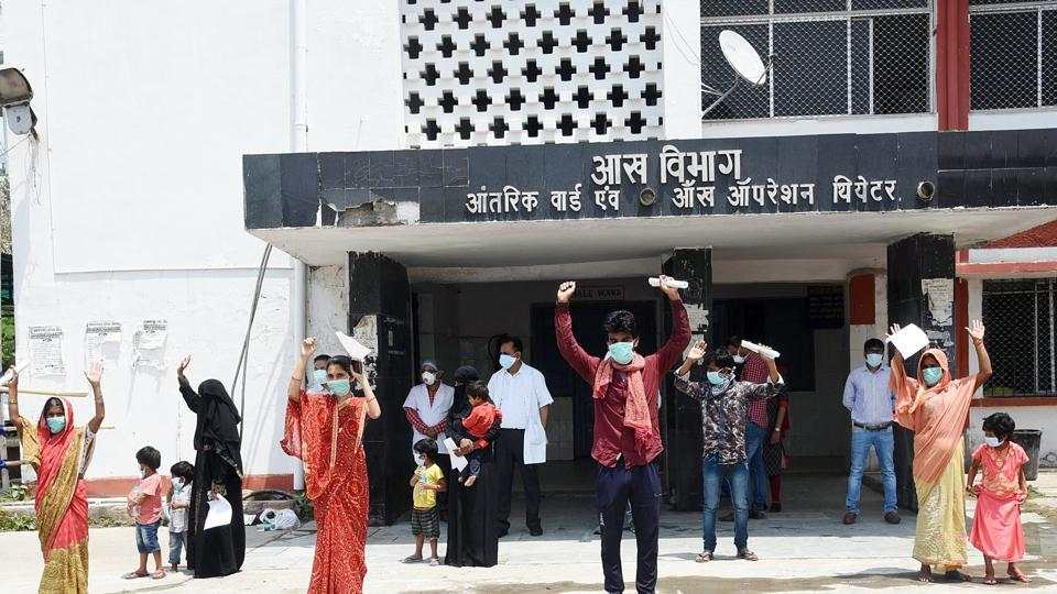 Patients who  recovered from Covid-19 flash victory sign after being discharged from Nalanda Medical College and Hospital (NMCH) in Patna on Thursday.