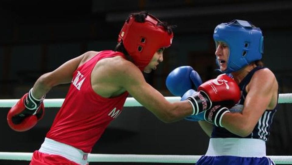Ayako Minowa (Blue) of Germany fights against Sonia Lather (Red) of India in the Women's 54kg preliminary match during the AIBA Women's World Boxing Championships on May 13, 2012.