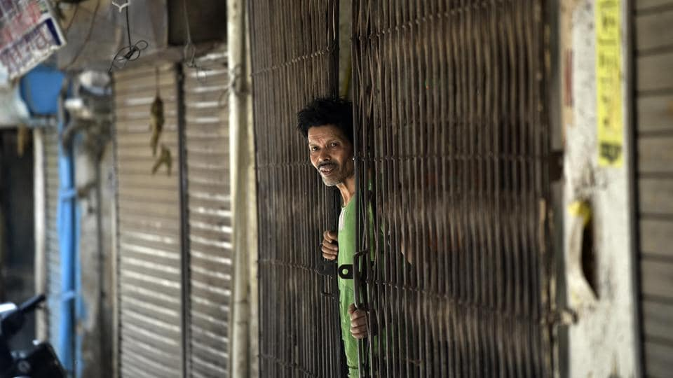 A man looks on while standing at the door of his house at J 4 Block of Khirki Extension in Khirki Village, one of the red zones now sealed, during lockdown against coronavirus, in New Delhi, India.