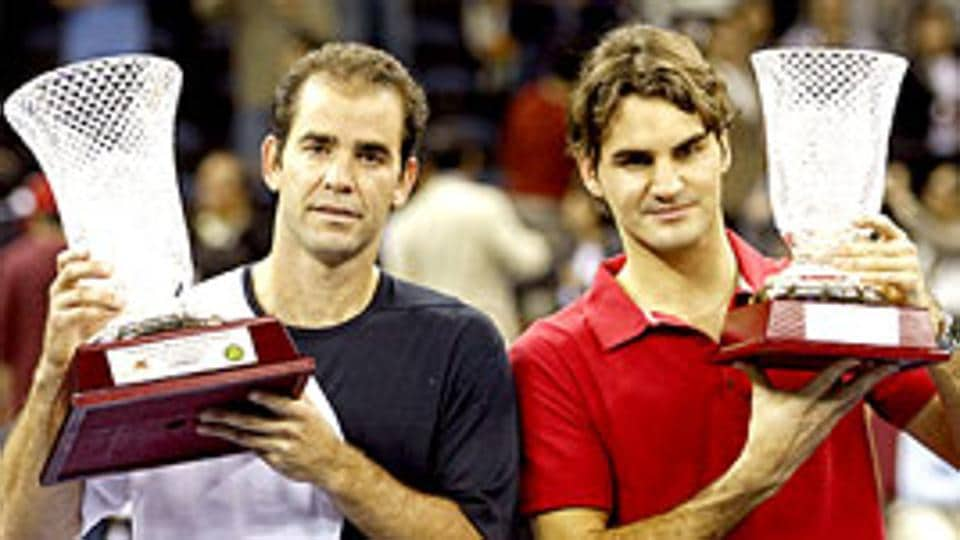 The Kings together: Switzerland's Roger Federer and Pete Sampras of the U.S. celebrate after their friendly match in Macau on Saturday.