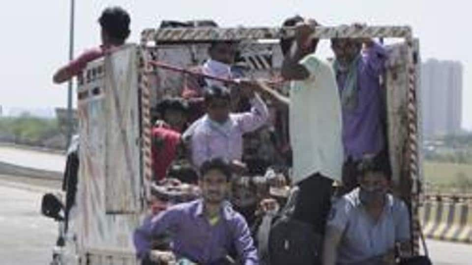Migrant workers hitch a ride after a nationwide lockdown was announced on March 24, Noida, March 29, 2020