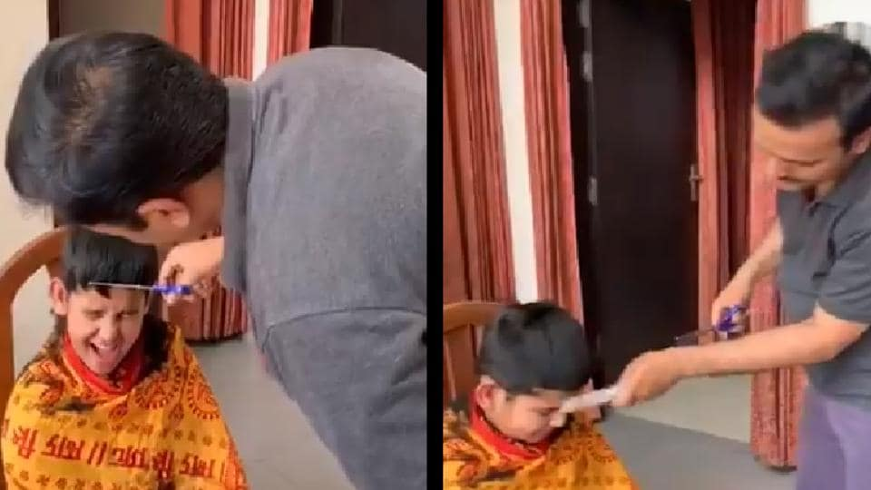 A video showing him cutting the children's hair has gone viral on social media.